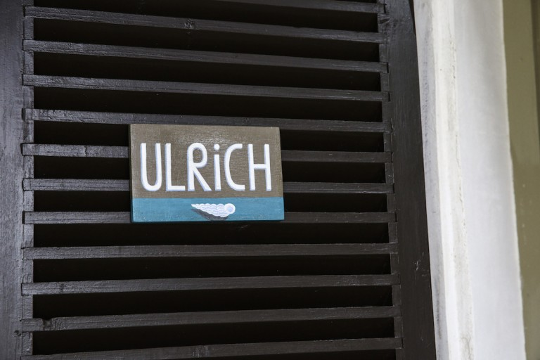 Handmade painted sign at the entrance of Ulrich room