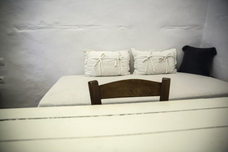 Eckart room details traditional handmade linen and furniture